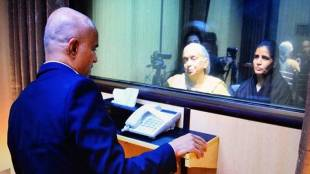 Kulbhushan Jadhav speaks to his wife, Chetna, and mother, Avanti, at the Pakistan foreign affairs office.
