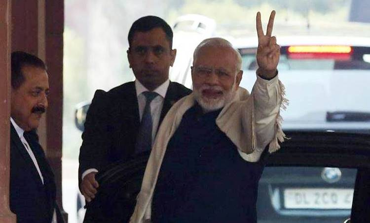 Prime minister Narendra modi shows victory sign as he enter in the parliament house in new Delhi on Monday photo Renuka Puri