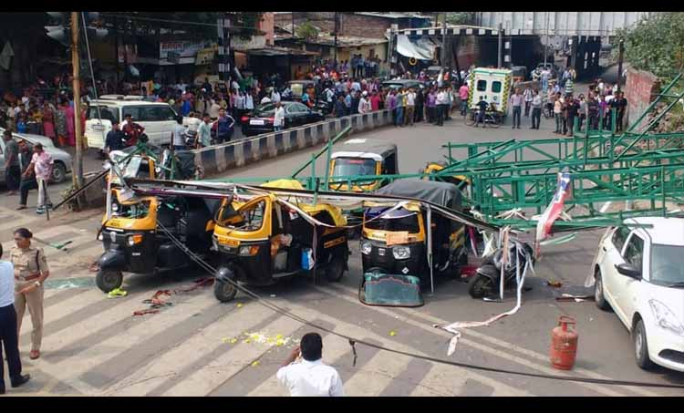 Pune Four killed as hoarding on rail premises collapses on road