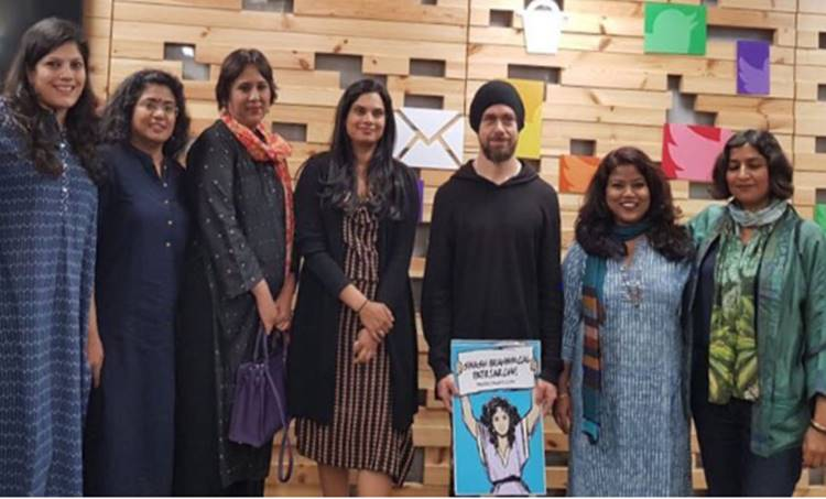 """Twitter CEO Jack Dorsey is seen in this photo holding a poster which says """"Smash Brahmanical Patriarchy."""" The poster has caused a backlash in India against the CEO and Twitter."""