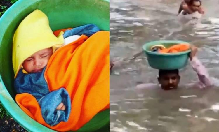 Police officer rescues baby,കുഞ്ഞ് പൊലീസ് ഉദ്യോഗസ്ഥന്, Vadodara Rain, വഡോദര മഴ,Cop Baby, Vadodara Police Officer, ie malayalam