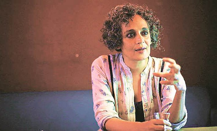 kerala bjp, arundhati roy speech withdrawal, arundhati roy come september speech, calicut university textbook arundhati roy speech