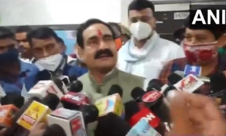 MP minister mask, Narottam Mishra, Madhya Pradesh Home Minister Narottam Mishra, MP congress, BJP leader denies to wear mask, MP coronavirus cases, Indian express